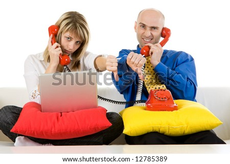 A couple of business people talking on the telephone.
