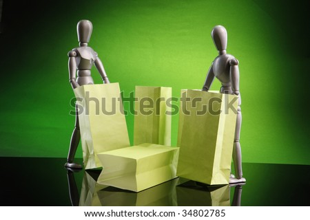 A couple of dummies examine paper bags