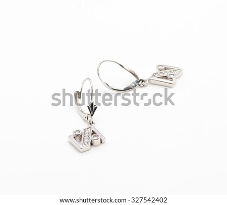 a couple of gold earrings with diamonds isolated on white background