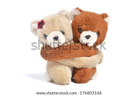 A couple of teddy bears hugging. Isolated on white background. - stock photo