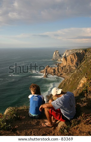 A couple of tourists in Cabo da Roca, Lisbon, the most ocidental land on Europe - stock photo