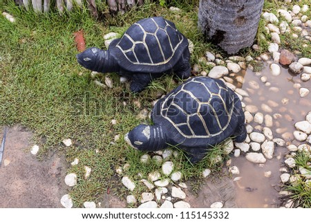 A couple of turtles decorated in the garden. - stock photo