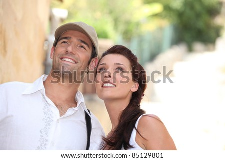 A couple on a holiday trip. - stock photo