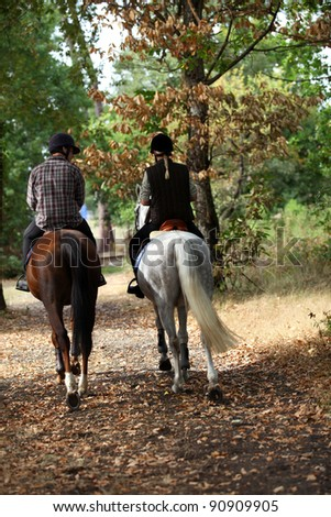 A couple on a horse ride. - stock photo