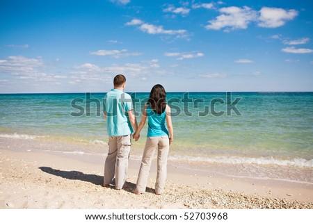 A couple on beach - stock photo