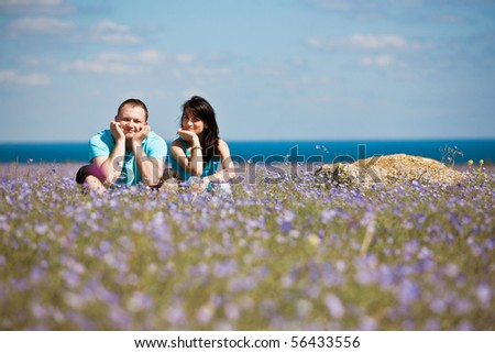 A couple on field have fun - stock photo