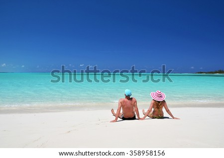 A couple on the beach of Exuma, Bahamas - stock photo