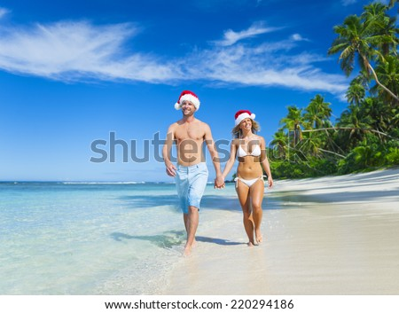 A couple relaxing on the beach on Christmas. - stock photo
