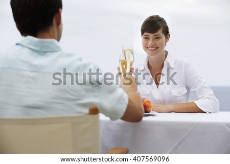 A couple sharing a romantic meal - stock photo