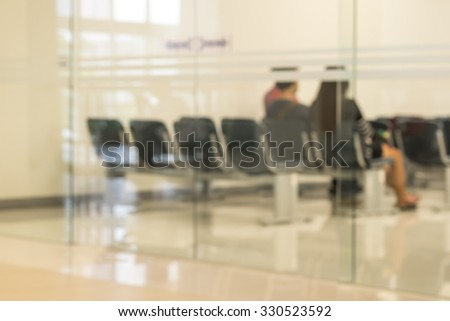 A couple sitting and waiting to see a doctor for medical background - stock photo