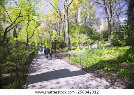 A couple takes walk in Central Park in the Spring, New York City, New York - stock photo