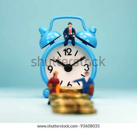 A couple walking up a golden coin stairway, with the bank manager ahead of them sat on a pastel blue alarm clock, asking the question, can you last the financial journey. - stock photo