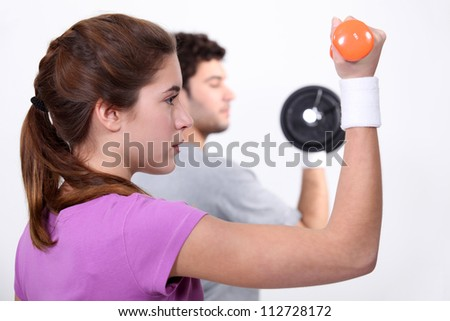 A couple working out. - stock photo