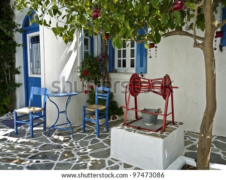 A courtyard with a well in a village house in Greece, - stock photo