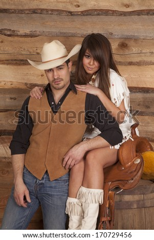 A cowboy and Indian are together looking serious. - stock photo