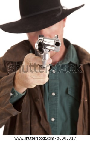A cowboy looking down the barrel of his pistol.