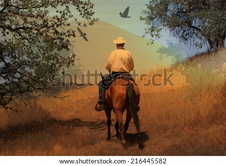 A cowboy riding his horse in the mountains with  crows flying above. - stock photo