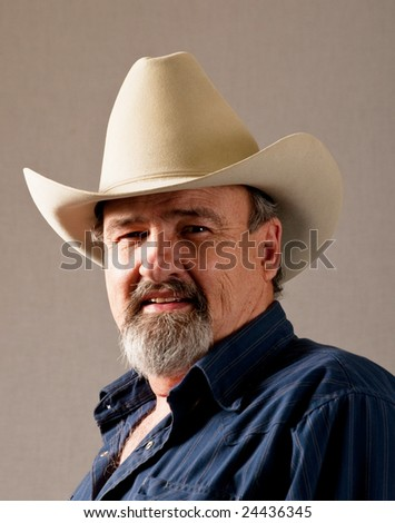 A cowboy standing firm in his beliefs - stock photo