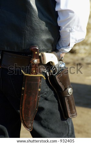 A cowboy waits his turn at a shooting competition. - stock photo