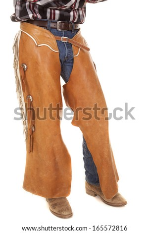 A cowboy with his chaps and boots on ready for the day. - stock photo