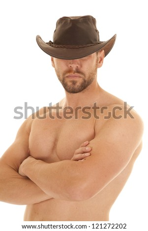 A cowboy without a shirt on and with his brown cowboy hat on. - stock photo