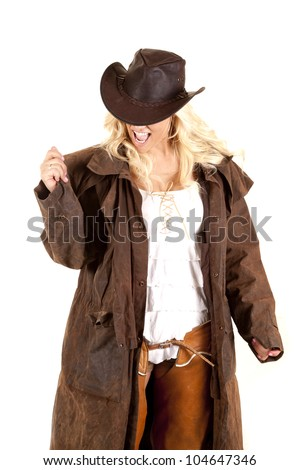 A cowgirl is wearing a duster and is very happy. - stock photo