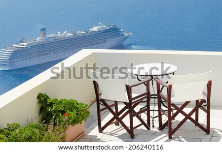 A cozy table for dlancha overlooking the Caldera and the steamer - stock photo