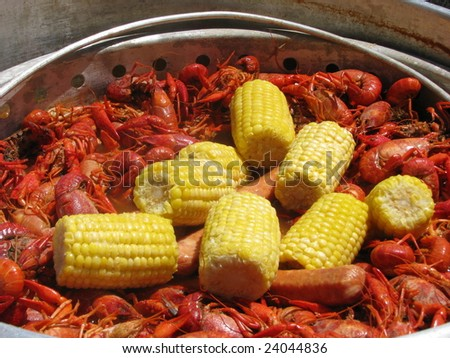A crawfish boil in south Louisiana including crawfish, corn and sausage being cooked on an outdoor cooker.