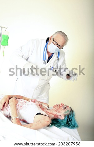 A crazy mad scientist experiments on Re-Animating Dead Zombies in an attempt to bring them back to life as his Slaves to do his bidding. Artistic Coloring and processing of images.   - stock photo