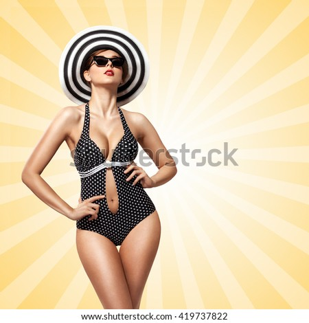 A creative vintage photo of a beautiful pin-up bikini model in polka dot bikini sunbathing on colorful abstract cartoon style background. - stock photo