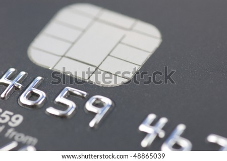 A credit card showing a close up of the chip - stock photo