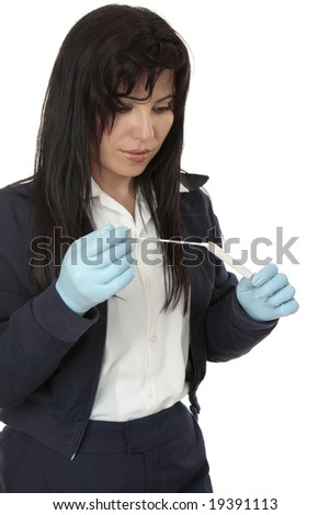 A crime  investigator with a dna sample swab evidence. - stock photo