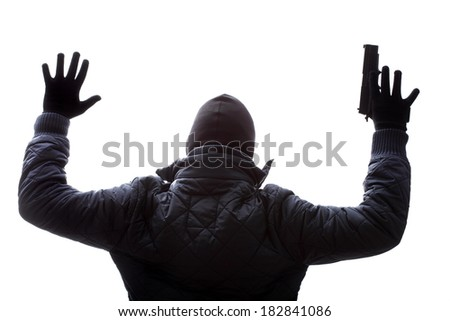 A criminal giving up by holding his hands up - stock photo