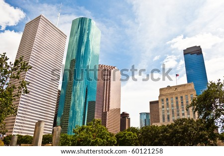 a crisp cityscape of the downtown Houston Texas skyline on a nice summer day - stock photo