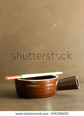 A crock with chopstick