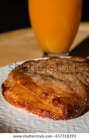 A Croissant filled with Cream - Tasty and Delicious Breakfast Pastry, Fresh from the Bakery - stock photo