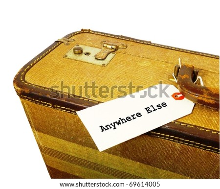 "a crop of a worn vintage suitcase with a white tag that says ""Anywhere else"" attached to the handle isolated on a pure white background - stock photo"
