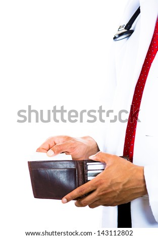 A cropped image of a male doctor holding a wallet and pulling out a card isolated on white background . Health care reform. - stock photo