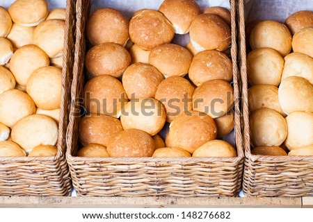 a cropped image of a variety of white bread buns in three baskets