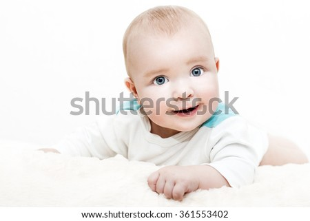 A cropped shot of an adorable baby boy lying on a blanket - stock photo