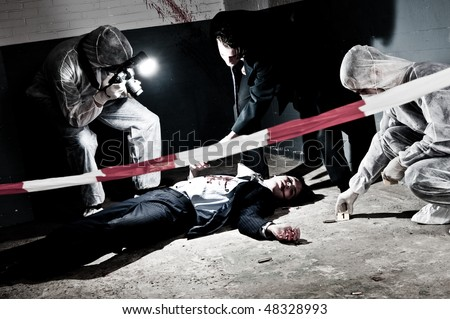A cross processed murder scene with two forensic team investigating a crime on a businessman in a basement - stock photo