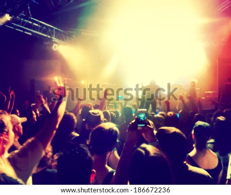 a crowd of people at a concert  - stock photo