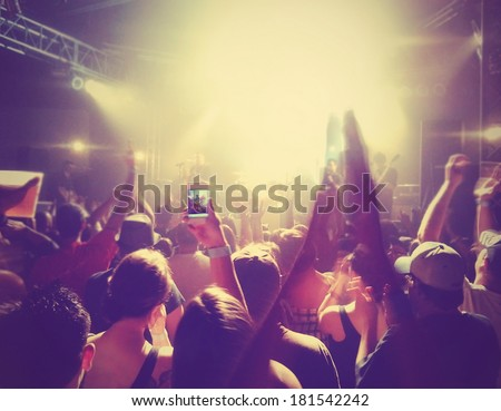a crowd of people at a concert done with an instagram like filter - stock photo