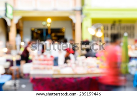 A crowd of people moving on the old town city night street defocused blurred abstract image at phuket thailand