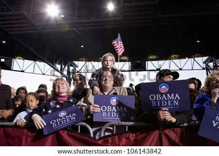 A crowd of supporters watching US Senator Barack Obama at Change We Need Presidential rally, October 30, 2008 at Verizon Wireless Virginia Beach Amphitheater in Virginia Beach, VA - stock photo