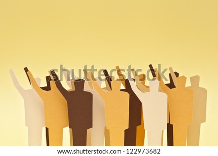 A crowd rising the hands up on agreement - stock photo