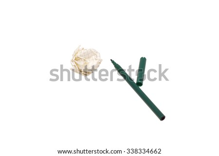 A crumpled piece of paper and a green felt-tip pen. Isolated on white.                                - stock photo