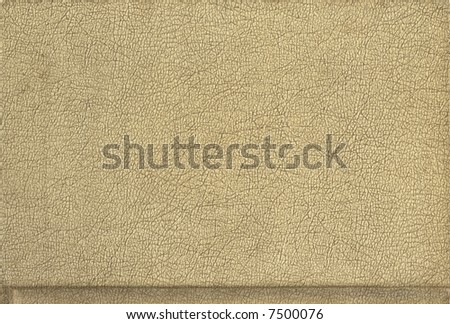 A crusty tan piece of leather, suitable for a background. - stock photo