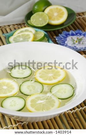 A cucumber-citrus aromatherapy bath. - stock photo