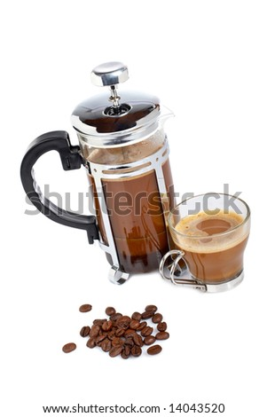 A cup and coffee pot with beans, reflected on white background
